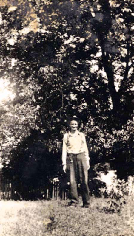 Ousley standing under his favorite pecan tree