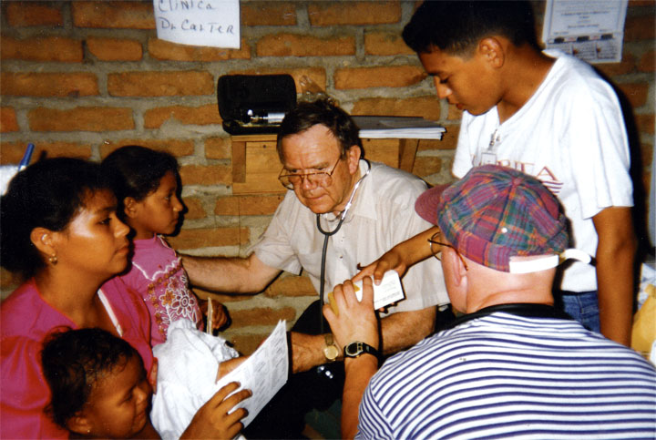 Dr. Carter at work during a mission trip to Honduras in 1989.