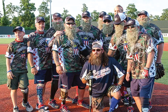 Jacob with Willy Robertson and the Wounded Warriors Amputee softball team.