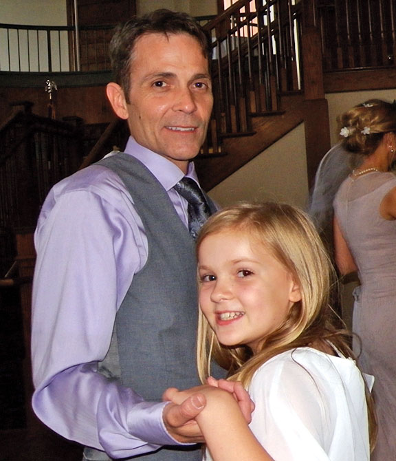 Mike dancing with his nine-year-old daughter Isabella at his brother's wedding this past June.