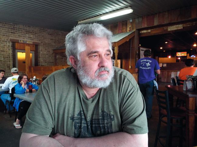 Brad pondering Cajun Menu