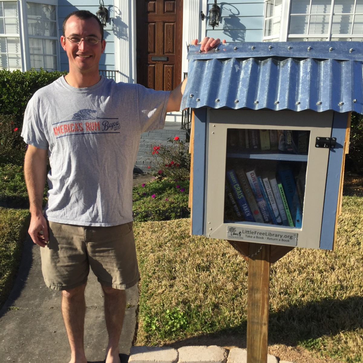 Joe Torcivia with the library box in front of his home on Woodruff.
