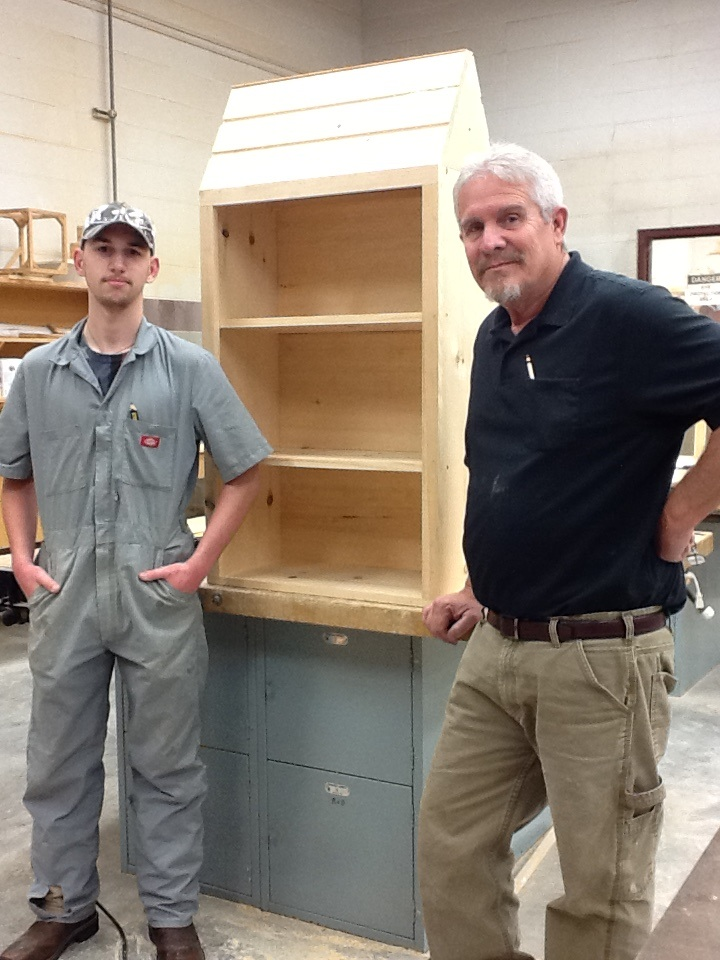 Box in progress; Barbe student David Little, left; and T&I carpentry instructor Royce Allen.
