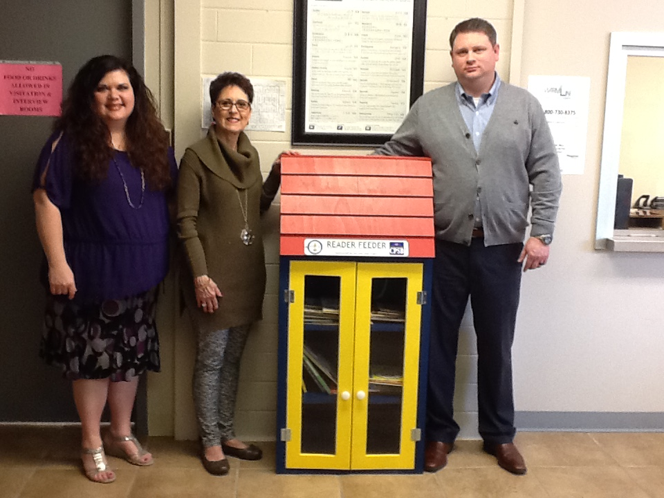 Dawn Sahualla, Area Director of Child Welfare- Dept of Children and Family Services; Jean Evans, Reader Feeder Sponsor;  and Justin Mahoney, Supervisor College St. T&I, with Reader Feeder at Dept. Of Child and Family Services.