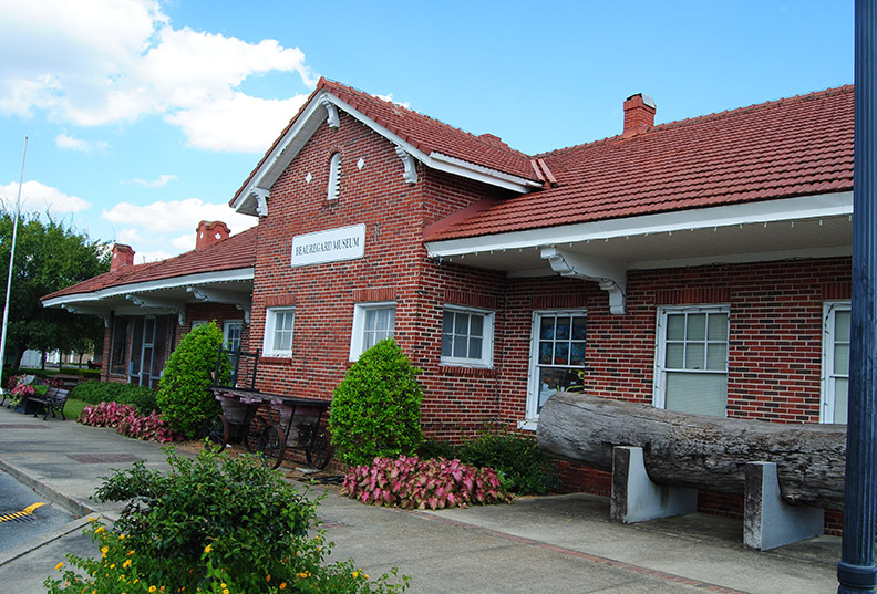 BEAUREGARD MUSEUM The Beauregard Museum was created from the original depot of the Kansas City Southern Railroad depot. Not only does it have a railroad car open for visitors to step through, but the museum also holds the Lois Lofton doll collection of more than 3,000 items.