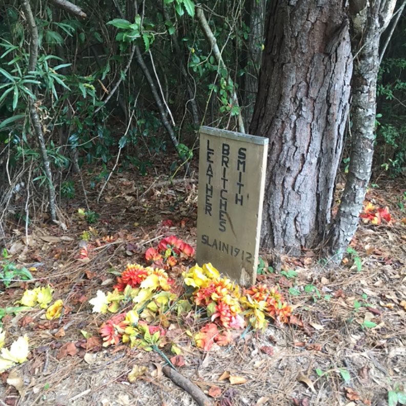 The gravesite of notorious Beauregard Parish outlaw Leather Britches Smith in the Merryville Cemetery is marked only by a wooden plaque commemorating the outlaw's death in 1912. Recently, some visitors have left gifts of fall-colored flowers. Many locals say visitors from outside the area are inspired to visit the spot during the Halloween season.