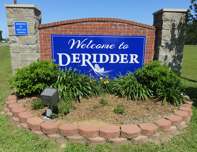 WELCOME SIGN New welcome signs placed along the entrances to DeRidder's city limits pay homage to DeRidder's beginning with the image of a pinecone placed beneath the city's name